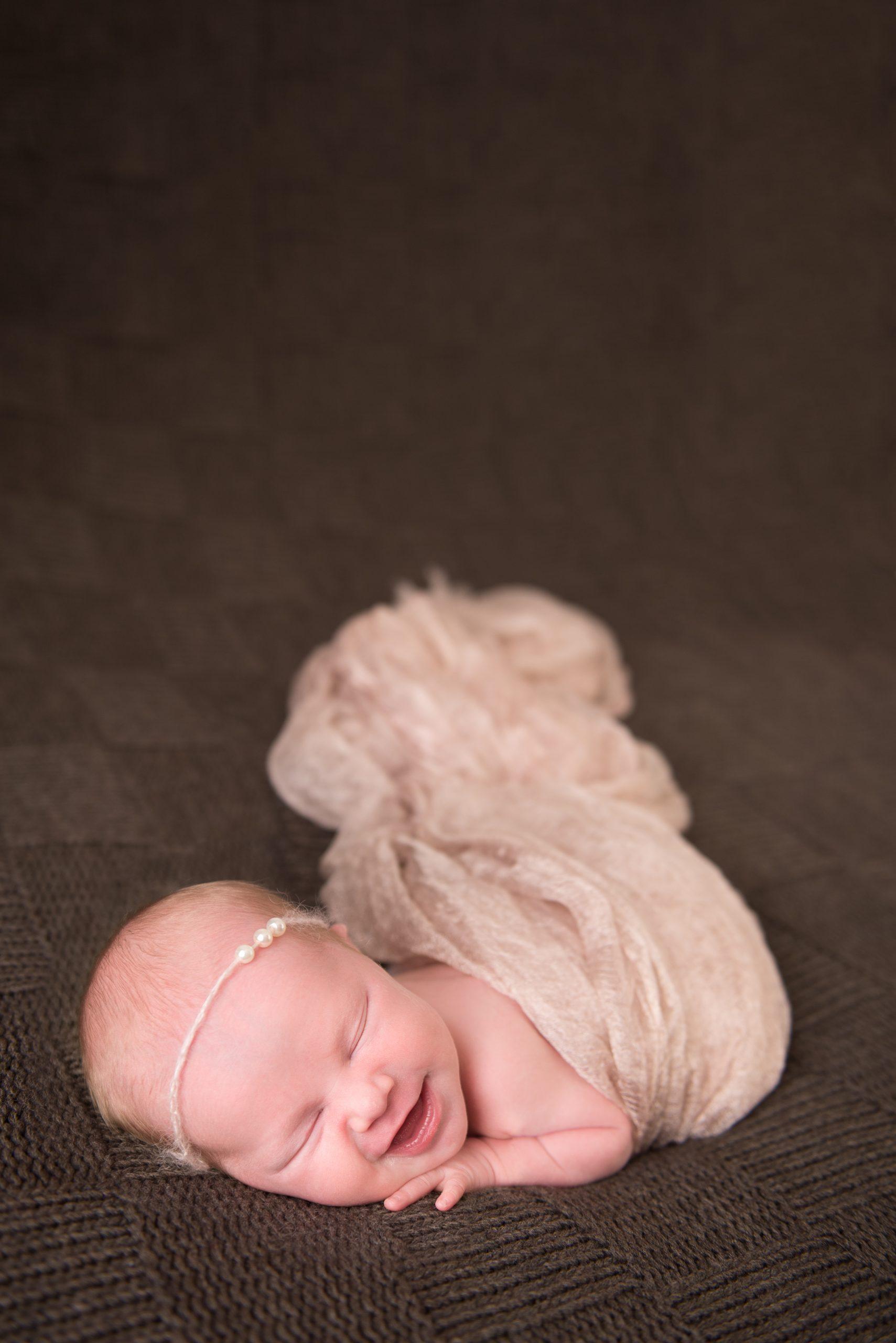 photo of newborn smiling