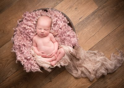 newborn baby girl pink curls wooden bowl pink silk